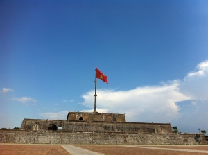 Vietnam flag is flying under the sun